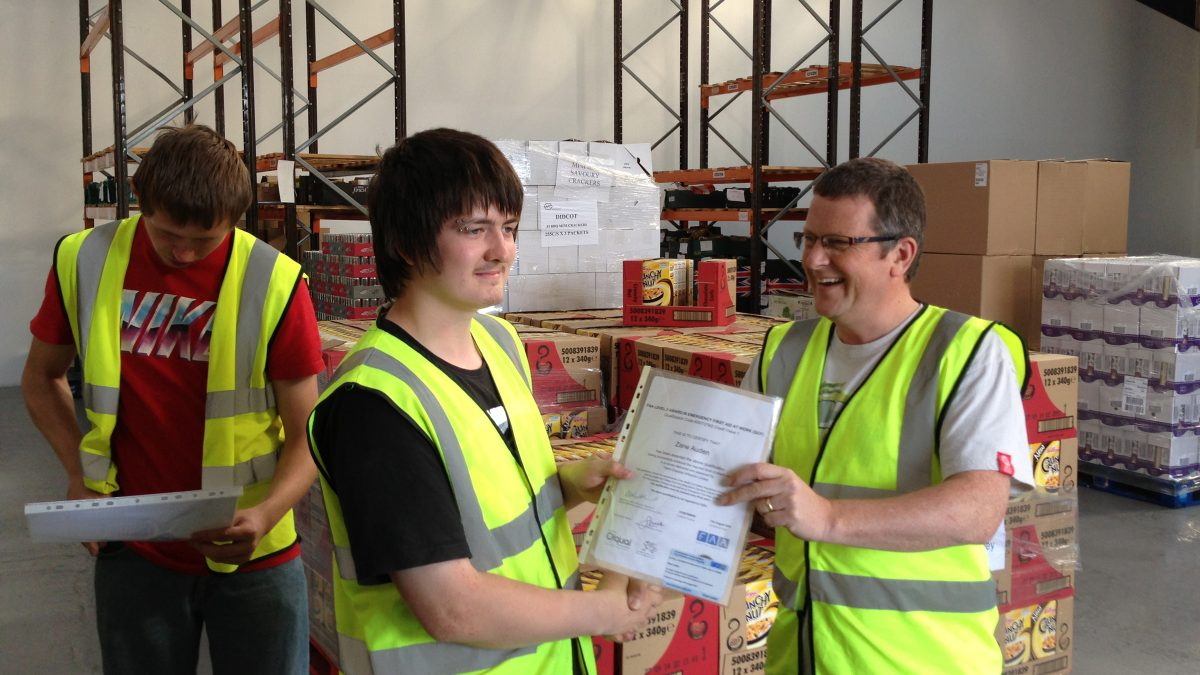 Richard Kennell awarding certificate for warehouse experience
